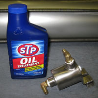 Lubricator and oil treatment
